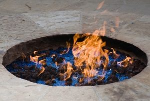 Ornamental fire pit with lava rocks and crystals.