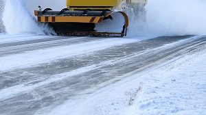 Snowplow clearing the snow from the street or property